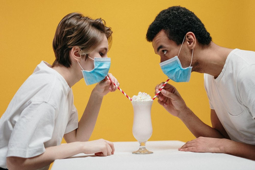 woman and man wearing facemask dating