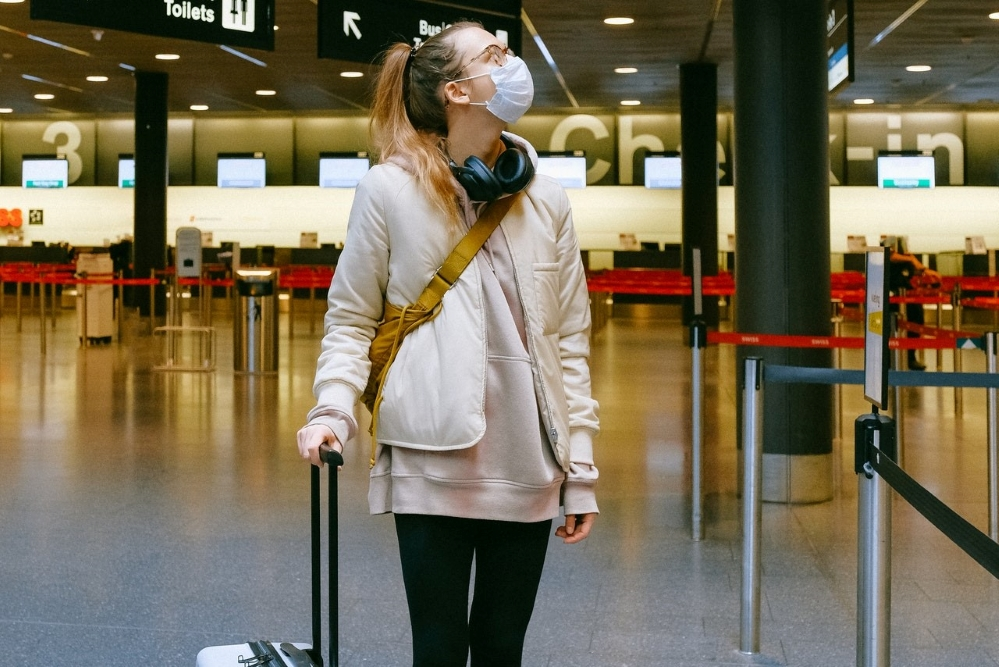airport travel during covid with face mask