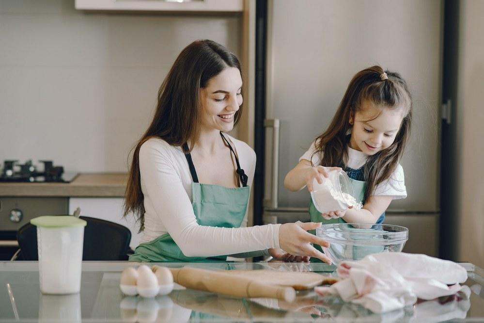happy single mum and daughter baking
