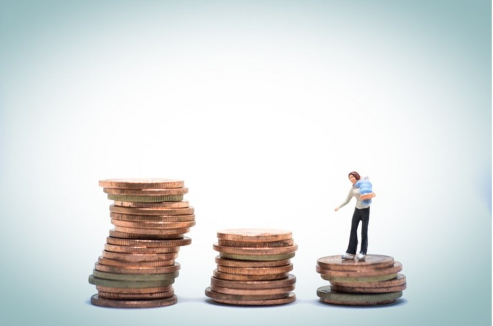 single parents and financial support: woman holding child standing on money