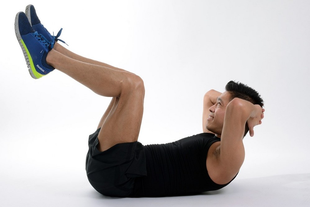 man exercising to keep fit