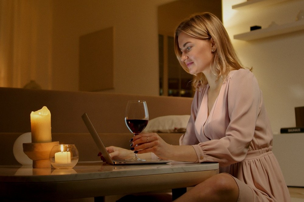 woman on online date with glass of wine
