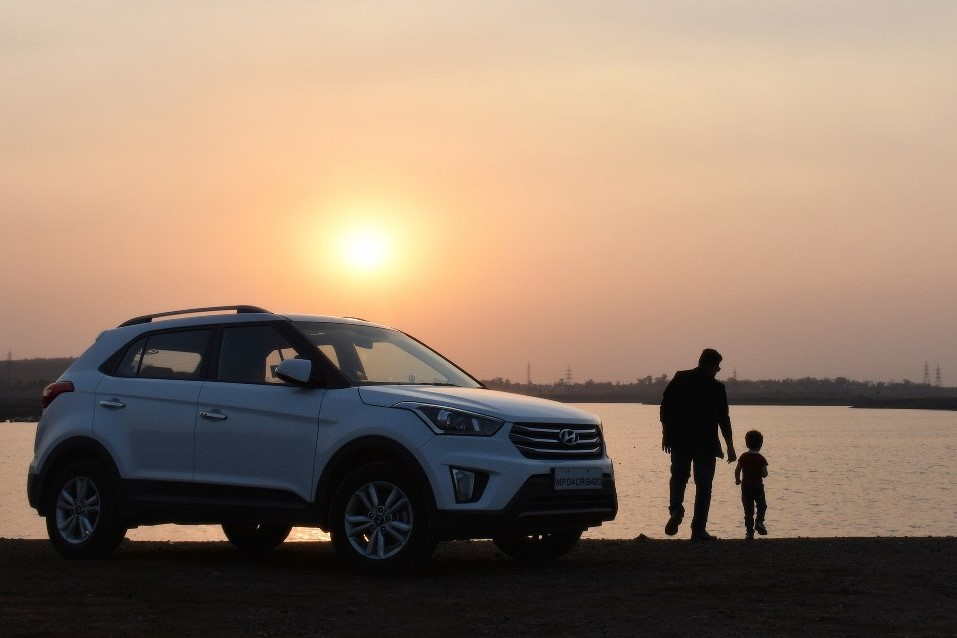 father and child during sunset on road trip