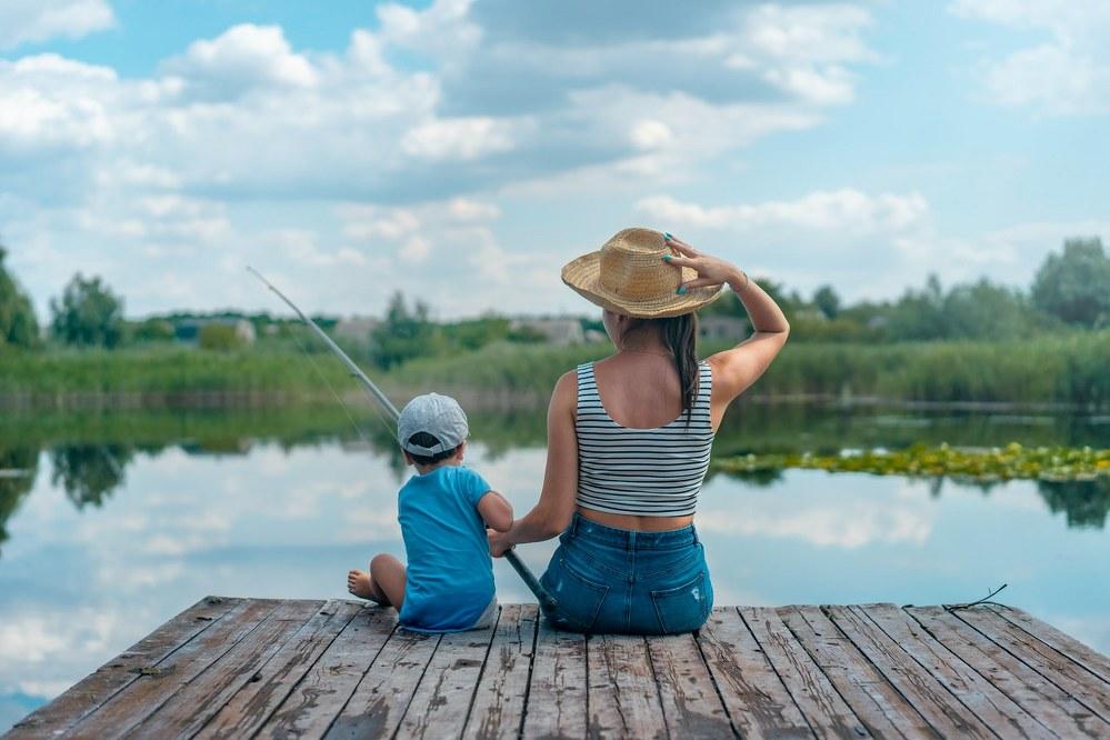 mum and son at fishing lake