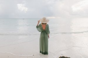 mum in maxi dress on beach