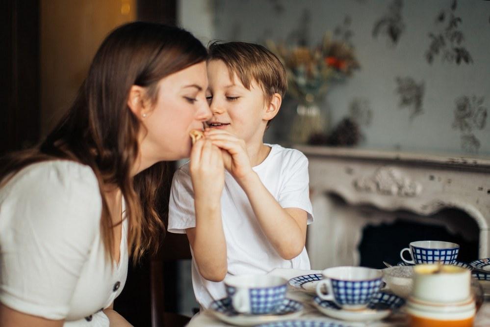 single mum and son in Paris creperie