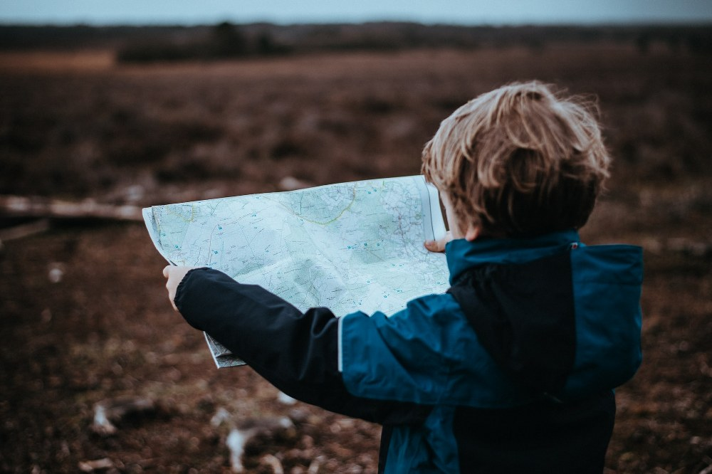 child holding map in South of England