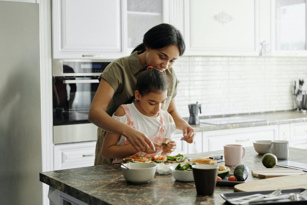 single mum mum cooking with child