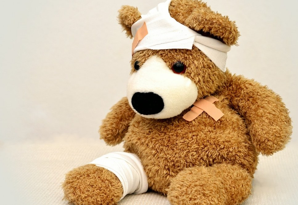 injured teddy with plasters