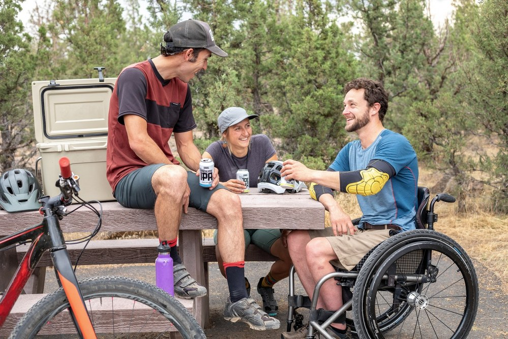 man in wheelchair with his friends